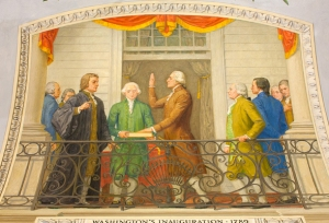 Mural by Allyn Cox in the U.S. Capitol depicts George Washington taking the oath of office in 1789 on the balcony of Federal Hall in New York City.  Architect of the Capitol photograph